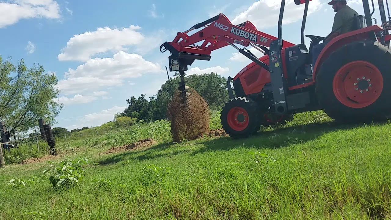 Kubota M62 With Hydraulic Skid Steer Auger