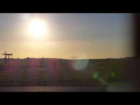 Evening landing at Ibiza airport. Iberia propeller aircraft.