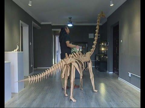 Chinese artist sculpts life-size paper dinosaur