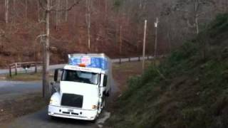 Tractor Trailer up a steep dirt road, World's best truck driver