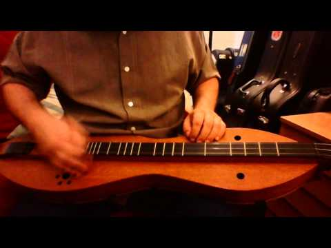 Redwing on mountain dulcimer