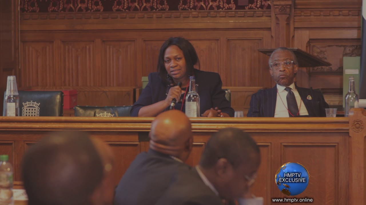 Margaret Bankole speaking at the House of Commons with Reverend Al Sharpton