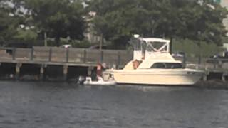 Drunk guys dock their boat in the rocks!