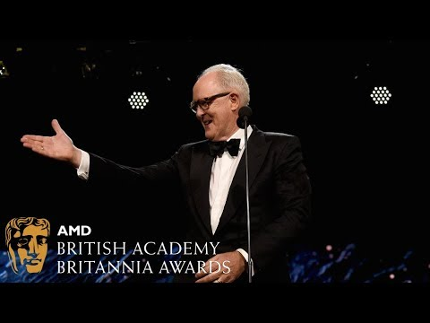 John Lithgow presents to Claire Foy at the Britannia Awards