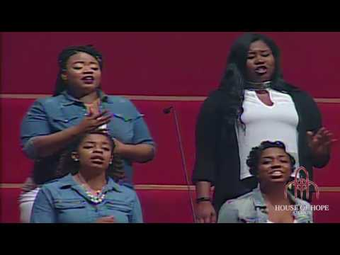 Young Adult Choir singing I Need You to Survive