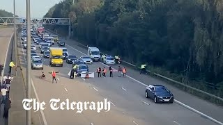 video: Priti Patel seeks court injunction after protestors run in front of lorries and cars on the M25