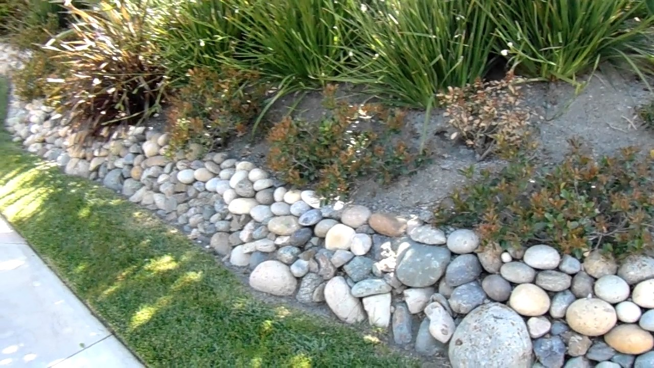 Noiyo sierra river rock retaining wall