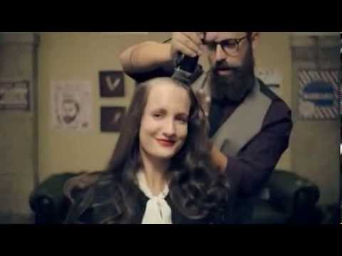 Women having their heads shaved