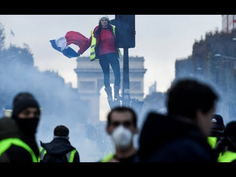 Police fire tear gas at 'yellow vest' fuel protesters in Paris