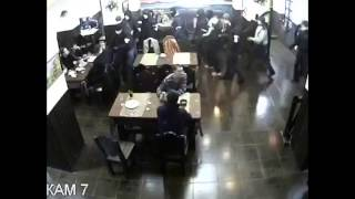 Just another day in Russia(About 35 armed masked men enter the restaurant and start causing trouble, this thug remains unimpressed. Pay attention to the guy in the middle. Armed men ..., 2014-11-17T20:23:50.000Z)