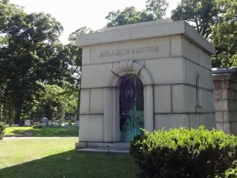 BigRich Roams GreenWood Cemetery  (ghost face peeking around tree)