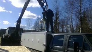 Lifting the dog box off the truck's bed