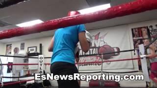 mma vs boxing: pro mma fighter (red) sparring golden gloves winner lisa porter