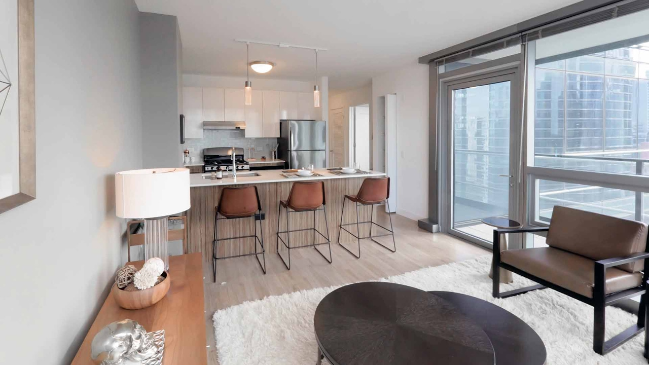 A 1 Bedroom Model With A Balcony At The New Wolf Point West Apartments