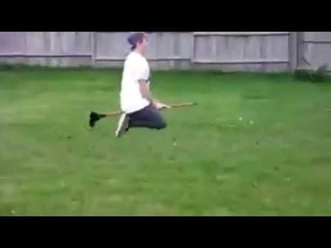Guy flying on broom.