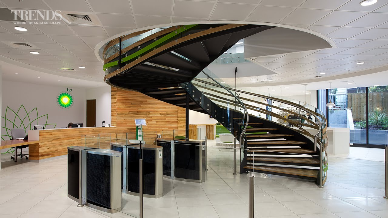 Modern office fit-out for BP with central spiral staircase ...