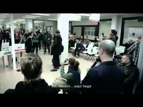 Flashmob Performs 'Here Comes the Sun' in Madrid Unemployment Office
