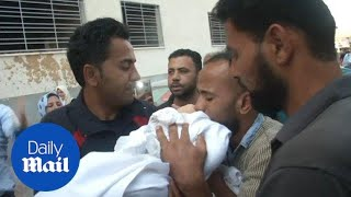 Relatives mourn Palestinian baby killed in Israel protest in Gaza - Daily Mail