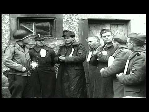 U.S. Army soldiers guard German SS-Totenkopfverbände (SS-TV) prisoners...HD Stock Footage