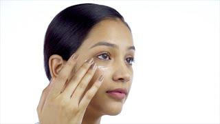 Closeup shot of a beautiful Indian girl with no makeup caring for her facial skin - Skin Care
