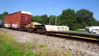 Westbound coal train meets Eastbound with mixed freight cars.
