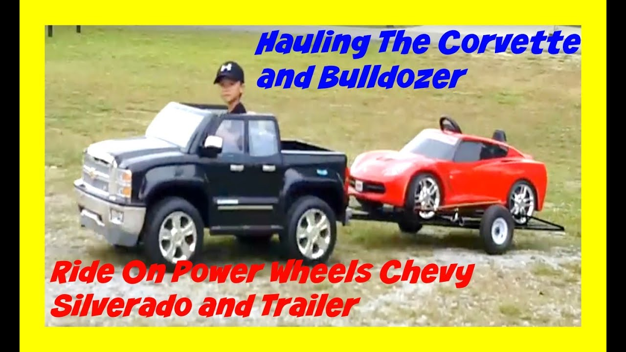 hauling his car and bulldozer with power wheels ride on. Black Bedroom Furniture Sets. Home Design Ideas