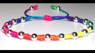 Repeat youtube video TUTORIAL COMO HACER UNA PULSERA MULTICOLOR DE NUDOS FRANCISCANOS Y CUENTAS PLATEADAS AJUSTABLE DIY