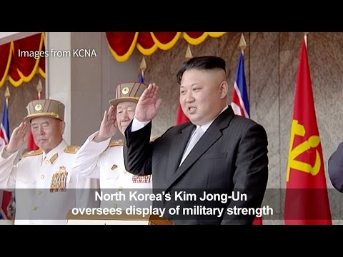 North Korea's Kim oversees parade of military strength