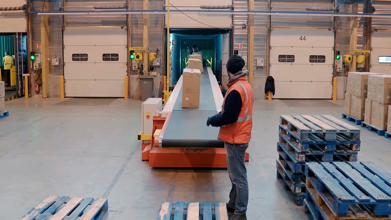 Transportador telescópico para la carga y descarga de camiones