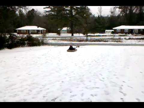 Amy and Christie sledding!