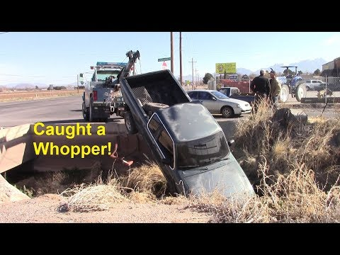 Truck In Ditch - Intersection of Picacho and N. Fairacres Rd.