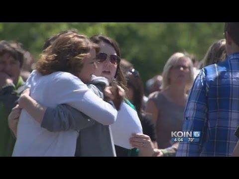Parents, children reunite after high school shooting