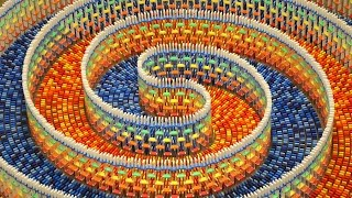THE AMAZING TRIPLE SPIRAL (15,000 DOMINOES)(I spent 25 hours spread over 8 days building this massive triple spiral structure with 15000 dominoes. Subscribe for my best project yet :) yo give it a share for all ..., 2016-09-10T17:00:03.000Z)