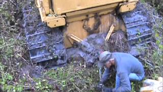 Caterpillar D6D stuck in mud while drum chopping