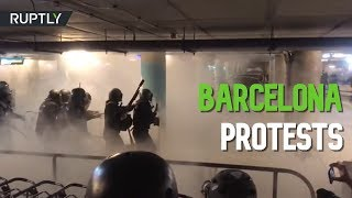Police use batons & tear gas against Catalan independence supporters in Barcelona