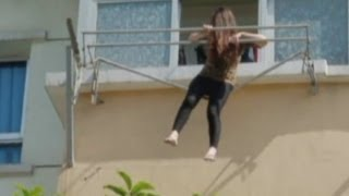 Drunk woman stuck on clothes hanger outside China apartment rescued