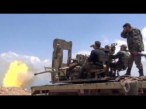 Syria: Pro-Assad forces hail recapture of key rebel-held town