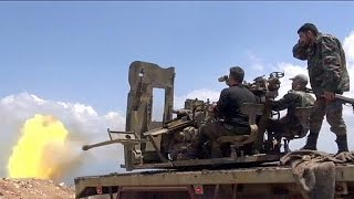 Syria: Pro-Assad forces hail recapture of key rebel-held town