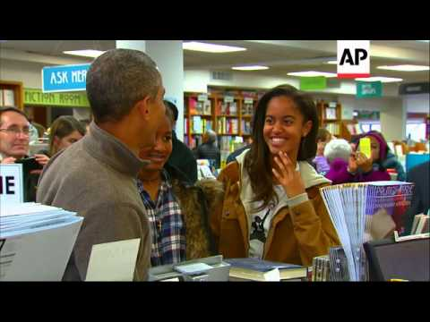President Barack Obama bought at least two bags of books at Washington's Politics and Prose bookstor