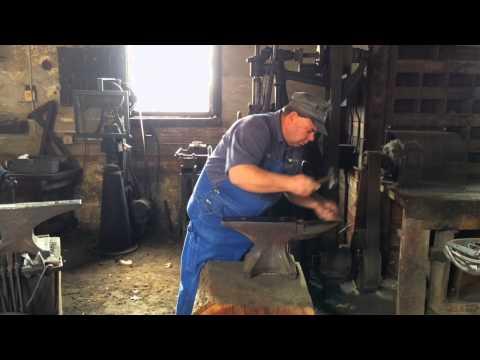 Biltmore Estate Blacksmith playing music on the Anvil