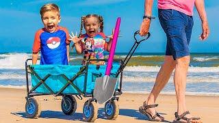 Diana e Roma brincam com o papai na praia