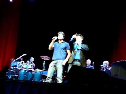 John Barrowman with partner Scott Gill singing in Glasgow music