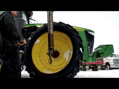 Changing a front tractor tire