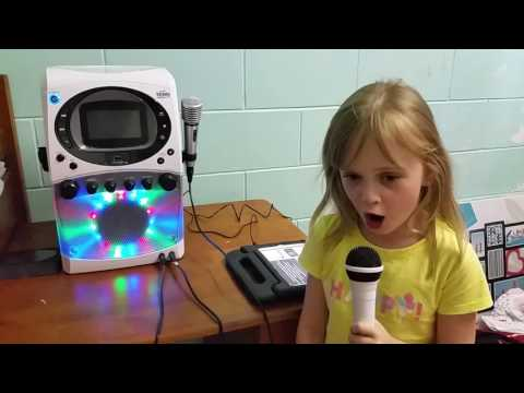 My gorgeous 5 year old girl sings with her new karaoke night  machine from Kmart