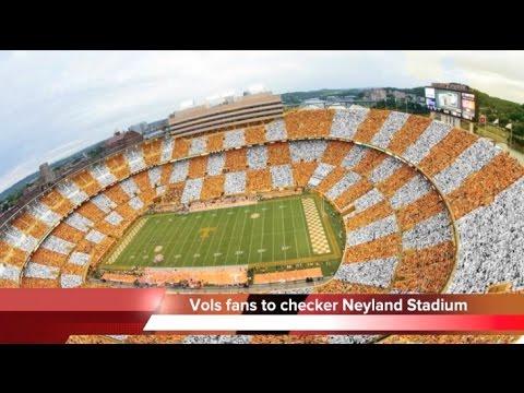 Vols fans Checker Neyland Stadium in orange and white