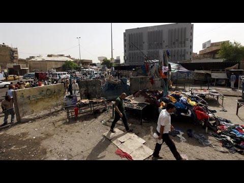 Iraq violence Baghdad market blast 'kills 17 people'