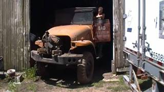 1951 Army truck pulled from building after 30 years storage.