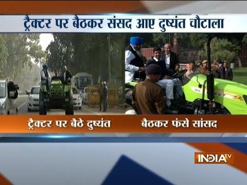 INLD Lok Sabha MP Dushyant Chautala rides a tractor to the Parliament