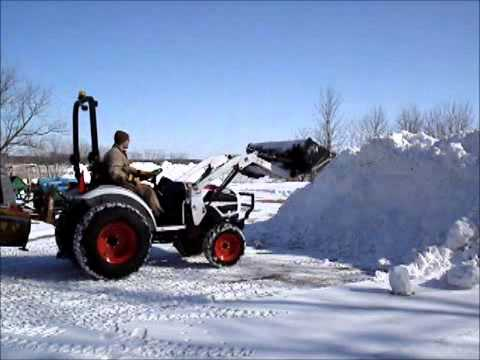 Bobcat Tractor Moving Snow Youtube