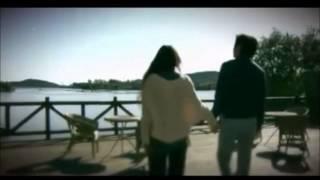 Repeat youtube video MI PRIMER AMOR-zhang sheng y xu ailian